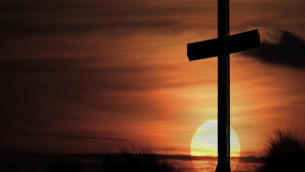 Laatste rustplaats (kruis met zonsondergang)